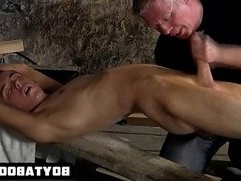 Horny tied up hunk having his hard cock tugged